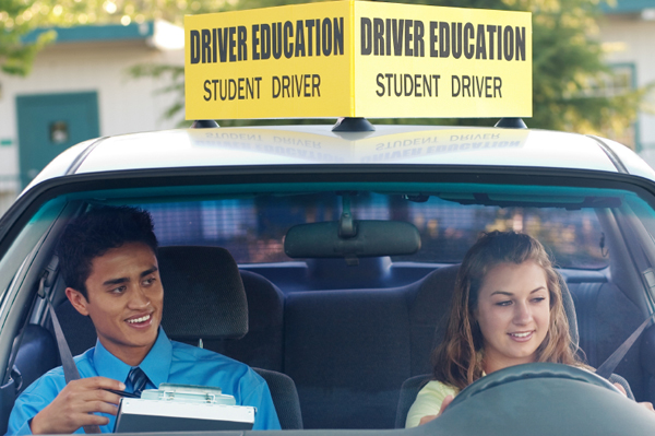 A teacher instructing a student on how to drive.